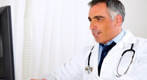 Doctor Using Computer - Medical Billing Service